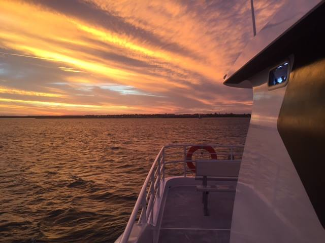 Whalesong Cruises Hervey Bay Sunset cruise beside boat