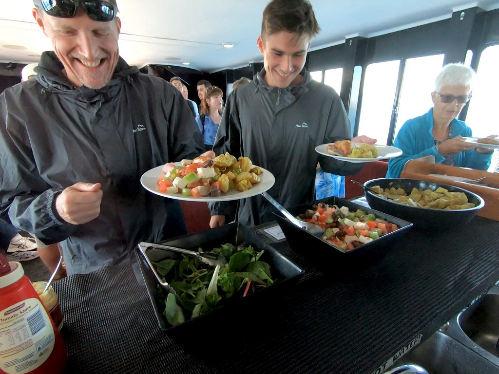 Whalesong Cruises Hervey Bay happy guests buffet lunch on morning cruise